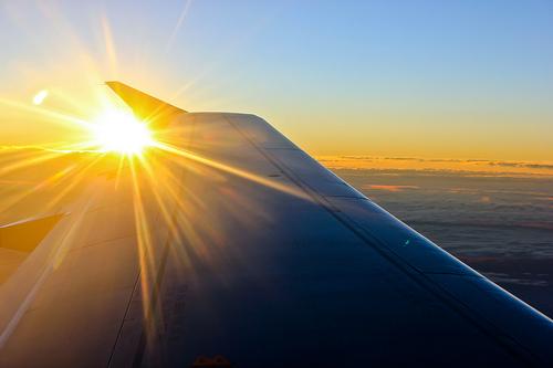 plane sun photo