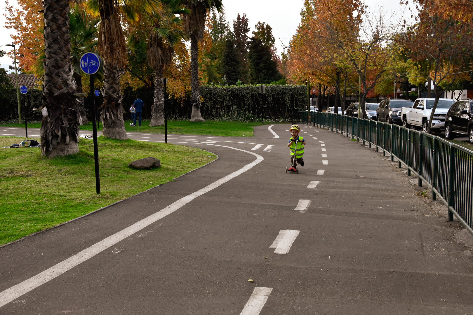 child on scooter in Las Condes bicycle park